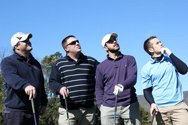 Hamming it up for the photographer is a foursome from Construction Specialties, including three alumni: David Bailey, '00, technology management; Brent D. Hamm, '98, plastics; and Anthony J. Peachey, '09, business administration. Team captain was Curtis M. Fessler (second from left).