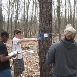 Forestry Field Day participants measure one of the countless trees within the ESC's spacious natural surroundings.