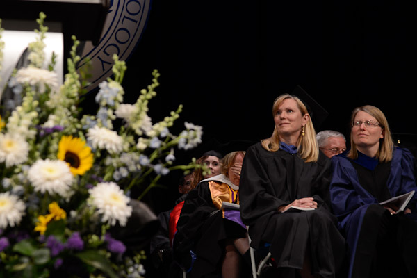 Gerri F. Luke, face buried at center, registers the shock of recognition as President Davie Jane Gilmour reveals her selection as Master Teacher.