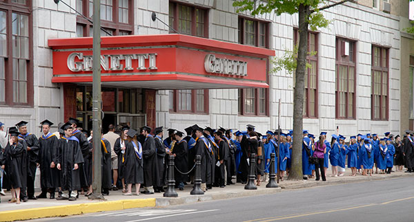 Near the corner of West Fourth and William streets – the crossroads between college life and the world beyond – students eagerly await graduation.