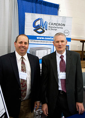 Cameron Manufacturing & Design representatives Frank LaViola Jr. (left) and Bryan Bush attend the Spring 2013 Penn College Career Fair. The company recently established a new scholarship fund for Penn College students from the Twin Tiers of New York and Pennsylvania.  (Photo by Marc T. Kaylor, student photographer)