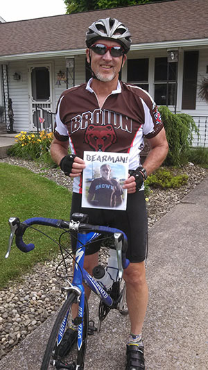 Carrying a photo of his inspiration, Ronald E. Kodish prepares for a 400-mile bicycle ride across Pennsylvania. (Photo by Teresa Kodish)
