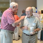 Williamsport residents Melvin Durrwachter, Class of '43, toolmaking (left), and Ralph Mills, '58, plumbing, share a laugh.