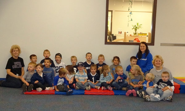 Youngsters and staff at the Dunham Children's Learning Center show off their Wildcat Pride, donning Penn College gear in a group display of spirit.