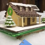 "Best of Show was awarded to a ""Homey Christmas Cottage"" made by Ching Chan."