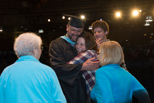 Kruppenbacher receives congratulatory hugs from family members following Friday's ceremony.