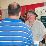 Rex E. Moore, ShaleNET U.S. consultant and instructor, talks with a visitor.