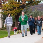 : Participants loop Penn College's Susquehanna Street walking mall during a student-organized walkathon that raised money for the I'm Able Foundation and to help occupational therapy assistant students pay for professional credentialing fees.