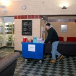 Steve Wenzel, from the Salvation Army in Williamsport, wheels a binload of donations through the Bush Campus Center.