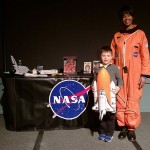 Cade Cassel assists storyteller Joanna Maddox, who portrayed astronaut Mae Jemison during Penn College's Feb. 2 Soul Food Dinner.