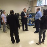 C. Hank White, director of the PIRC, answers a question in the extrusion lab.