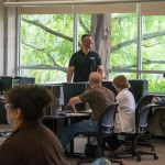 """Framed by a backdrop of Earth Science Center greenery, Walter J. Shultz Jr., director of the Office of Instructional Technology, leads a breakout session on """"Online Tools to Encourage Student Engagement."""""""
