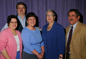 Joining President Davie Jane Gilmour in honoring Ann Seeley, second from left, are nominators Mary Trometter, left%3B Paul Mach, rear%3B and Michael Ditchfield.
