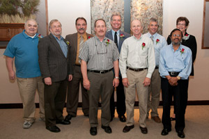 Among the newest Quarter Century Club members are, from left, James J. Folmar Sr., Joe (Gustav) Loehr, R. David Kay, Regis C. Kohler, Timothy E. Weston, Jeffrey L. Rankinen, Stephen A. Manley, Abdul B. Pathan and Dana R. Suter.