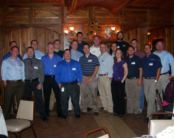 Construction Management alumni, with assistant professor Wayne R. Sheppard (right), fill The Valley Inn banquet room to celebrate their major's two decades of achievement.