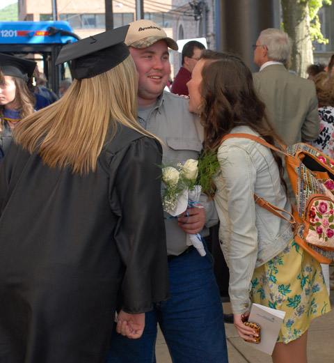 A postgraduate smooch for a flower-toting fan.