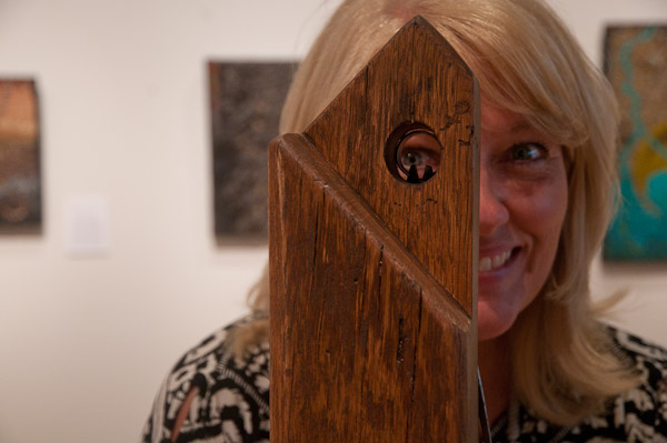 "Gallery Director Lenore G. Penfield joins in the fun offered by the unique ""Spyglass"" view."