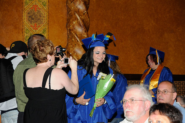 Rachel Marie Fasciano, earning an associate degree in surgical technology, draws attention with her whimsical commencement cap.