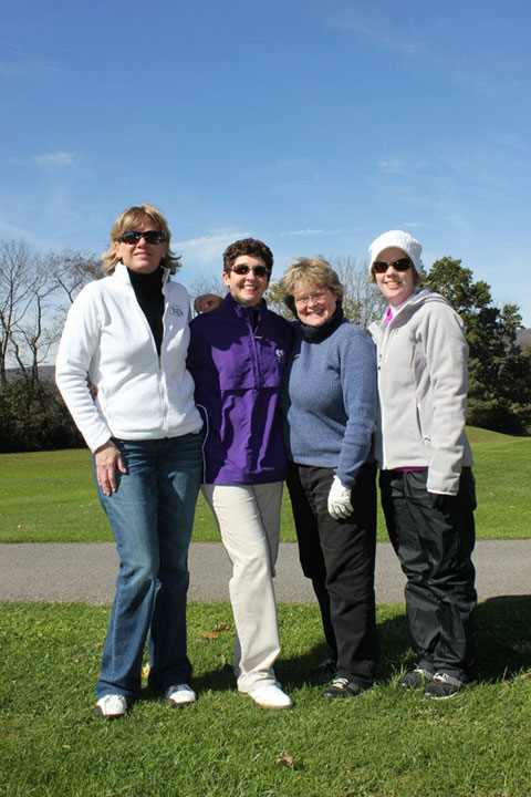 Terri L. Haluck, a 2000 graduate in occupational therapy assistant (left), assembled a team for the alumni golf tournament.