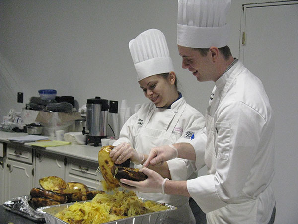 "Enjoying their ""prep time"" are culinary arts and systems majors Kristina M. Wisneski, of Whitehall, and Lewis D. Robinson, of Bellefonte."