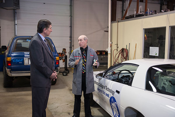 Baloga talks with Ronald A. Garner, automotive professor, during a Monday tour of the Advanced Automotive Technology Center west of main campus.