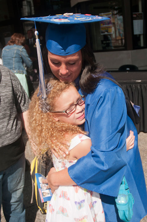 ... who sneaks a pre-commencement hug from a young well-wisher.