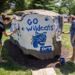 Student leaders Whitnie-rae Mays (left) and April M. Tucker blend artistic ability and school spirit in adorning a new campus landmark Monday.