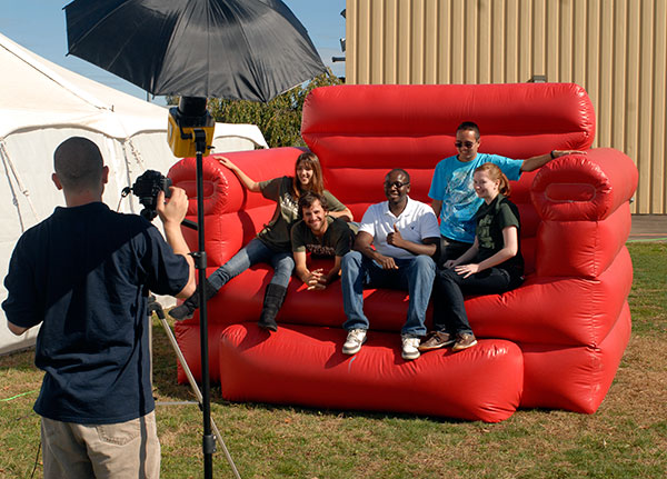 Members of the Wildcat Events Board climb aboard the oversized, inflatable chair for photo fun.