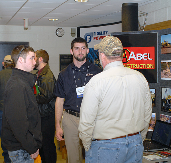 Corvin K. Oberholtzer, a 2012 graduate in residential construction technology and management, scouts at the ESC for Abel Construction Co. Inc.