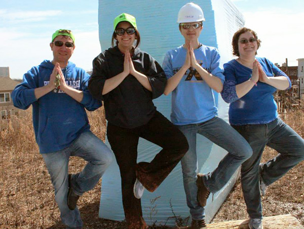 While some of their colleagues built a snowman, these students filled the downtime with jobsite yoga.