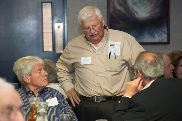 Talking shop, from left, are, John Dolan ('63, draftsman mechanical), Robert Schloder ('67 electrical technology), and business management alumnus Ronald Andrews.