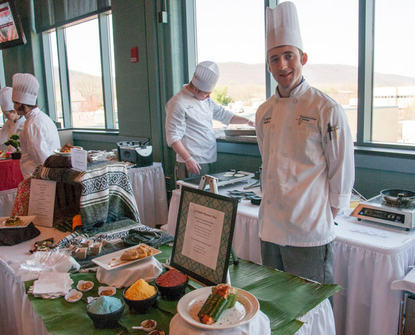"Logan R. Hinkley, of South Williamsport, staffs his ""Modern Moroccan"" entry for the Culinary Competition and Skills Assessment class."