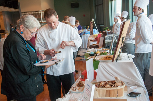 Judges Kim Morrison, of Cakes for Occasions in State College, and Chef Frank Priore, executive chef of the Westmoreland Club in Wilkes-Barre, sample a dish for scoring.