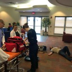 "A crew deals with a kidney-stone attack in the Bush Campus Center TV lounge, preparing to transport the ""patient"" to the ATHS radiography lab."