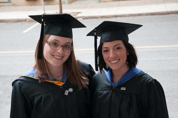 Desiree L. Buffington and Sari C. Arkin, both candidates for a bachelor's degree in nursing, pose while waiting to walk to the Community Arts Center.