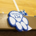 A foam Wildcat paw, a giveaway at a recent hoops doubleheader, lends silent support to the home team.