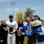 "Wildcat ""Athletes of the Year"" Courtney L. Gernert and Zachary A. Weil are congratulated at Bowman Field by (from left) Penn College President Davie Jane Gilmour, athletic director Scott E. Kennell and a very proud mascot. Gernert is a graphic design major from Palmyra; Weil, of Kutztown, is in the building science and sustainable design: building construction technology concentration. (Photo by Caleb G. Schirmer, student photographer)"