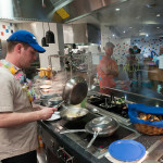 Jonathan T. Hall, an assistant cook at Dauphin Hall, prepares stir-fry ...