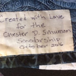 "... ""created with love"" in memory of Chester D. Schuman, a 34-year employee of the college ..."