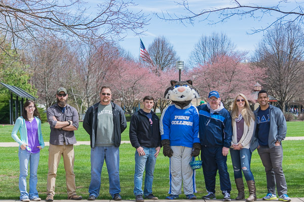 Team Wildcat, reporting for duty. From left are students Emily J. Jones, Jon R. Hallingstad Jr., Michael D. Seitzer and Alex C. Paris; the college mascot (in the person of student Efrem K. Foster); Chet Beaver, financial aid specialist, veterans services; and students Jennifer L. Nicholson and Bradly M. Lantz.