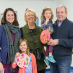 """Three generations celebrate the season at a decidedly family-friendly event. """"Mimi"""" Janice and """"Pappy"""" Robert Murphy, visiting from Pittsburgh, join their granddaughters, Macy (foreground) and Maura, and daughter-in-law Ashley R. Murphy, director of admissions."""