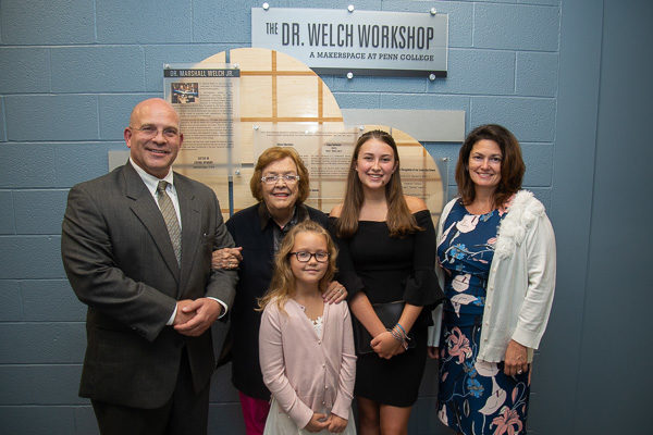 Marshall Welch III and his mother, Mary (left), are joined by his fiancée, Kristy Goss (right); Goss' daughter Hutton Howard (center); and Welch's daughter Abigail as they celebrate the dedication of the makerspace named in memory of Dr. Marshall Welch Jr.