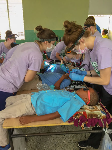 From left, Penn College dental hygiene students Megan M. Mecouch, of Peach Bottom, Lancaster County; Kayla C. Summerson, of Emporium, Cameron County, and Lori M. Weaver, of Newmanstown, Lebanon County, join classmates in cleaning children's teeth at a school in the Dominican Republic.