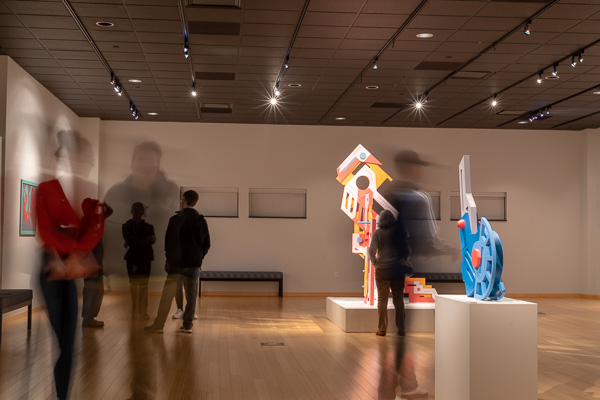 The blur of patrons moving among Repko's imaginative pieces marks a Nov. 7 gallery reception.