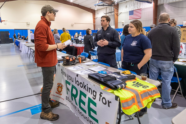 On-site accommodations are among the perks of joining a fire company, two of which recruited at this week's event. Loyalsock Volunteer Fire Co. members Nicholas D. Tartaglia, a residential construction technology and management: building construction technology concentration major from Doylestown, and 2019 emergency medical services alumna Alyssa M. Ogden talk with Sam T. Van Dermark, a manufacturing engineering technology student from Sayre. (The Old Lycoming Township Volunteer Fire Co. staffed a booth, as well.)