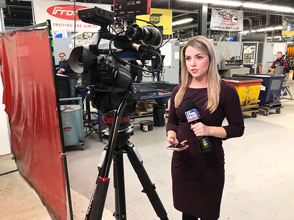 The journalist tells viewers that Penn College welding students have to complete a minimum of 144 hours of hands-on lab experience.