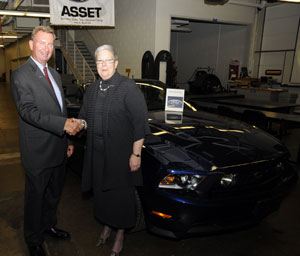 Pennsylvania College of Technology President Davie Jane Gilmour, in the college%E2%80%99s Ford ASSET lab with Jim Kelly, field service engineer for the Ford Motor Co.'s mid-Atlantic area, and a 2011 Ford Mustang recently delivered for instructional use.