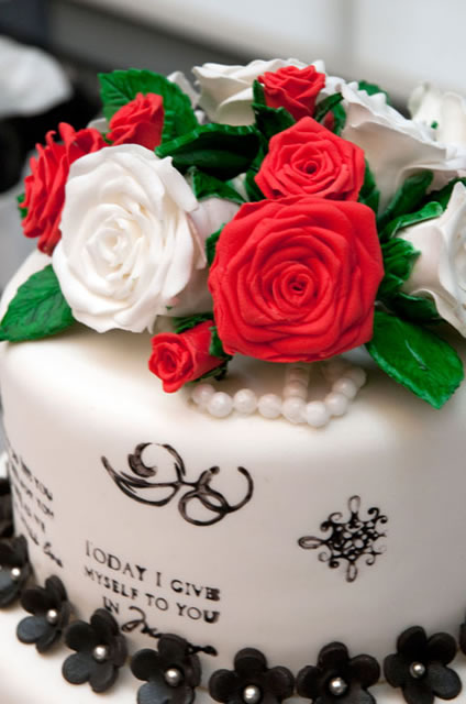 Bright roses and hand-stenciled letters top Elicker's entry.