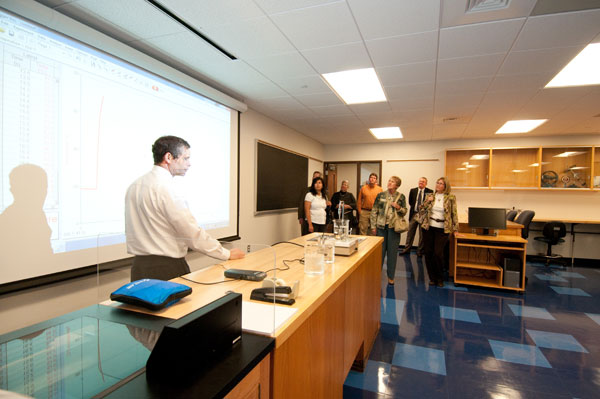 Joseph E. Leblanc, instructor of physics, shares scientific insights with a tour group.