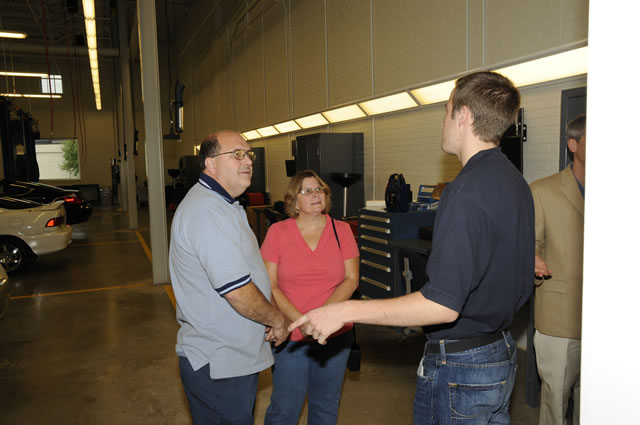 Student Ethan Griffin, an automotive technology: Honda emphasis major, conducts a tour of the ATC.